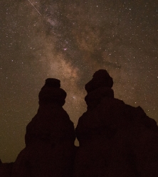 The milky way provides the backdrop for the shadows of the giant stone hoodoos of Bryce Canyon, Utah.