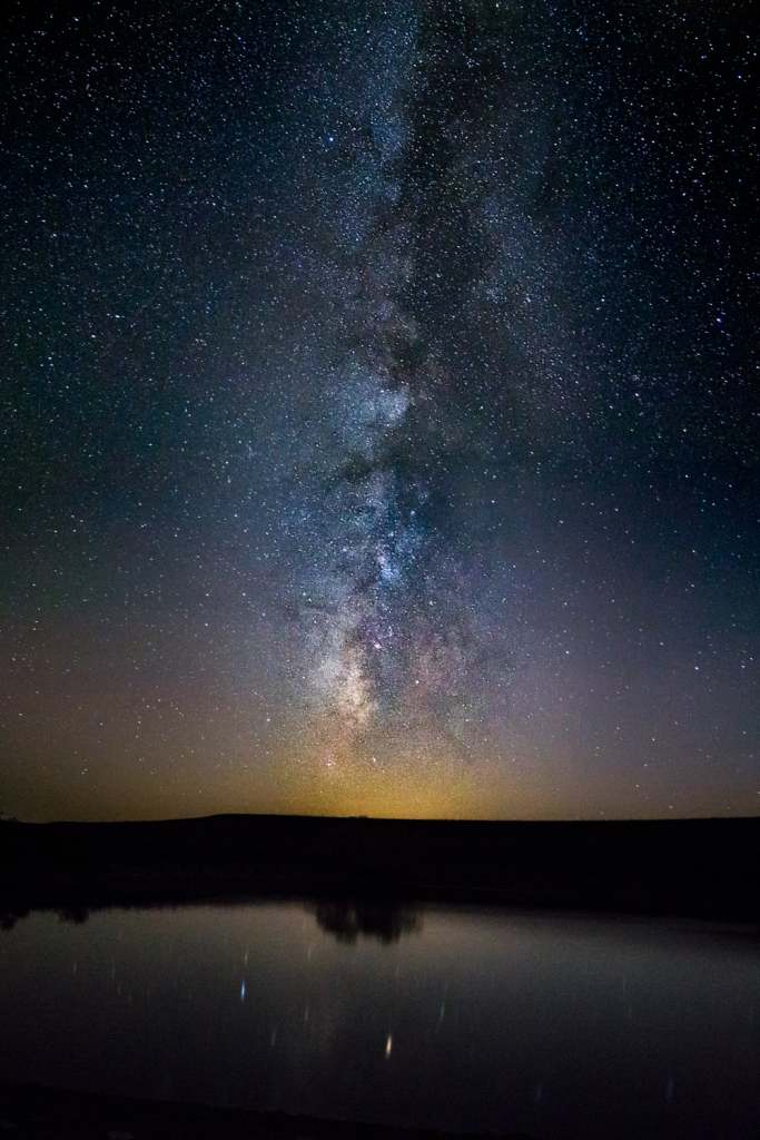 Milky way reflected off a pond in Tall Grass Prairie National Preserve, Kansas.