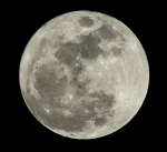 Close up and detailed shot of the full moon.