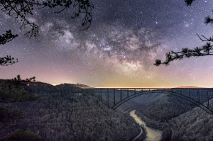 Another angle on the New River Gorge Bridge, this time I used morning twilight to provide lighting of the landscape. The Milky Way was taken at 3 am, while the landscape was shot about 2.5 hours later, approximately 45 minutes before sunrise. Additionally, 12 foreground shots were stacked in order to reduce noise.