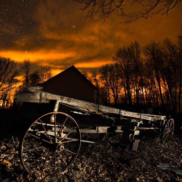 The wagon here was lit by quickly shining a flashlight over for just a few seconds during the exposure. The camera settings were: ISO 800, f/2.8, 20 secs.
